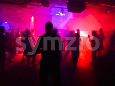 Young people dancing in club Stock Photo