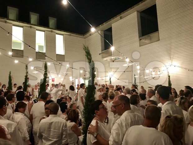 Ludwigsburg, Germany - July 22, 2017: Hundreds of people, all dressed in white only, gathered for a picnic dinner event ...