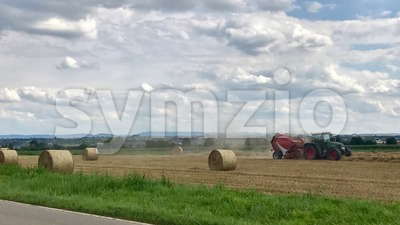 Tractor making hay bales Stock Photo