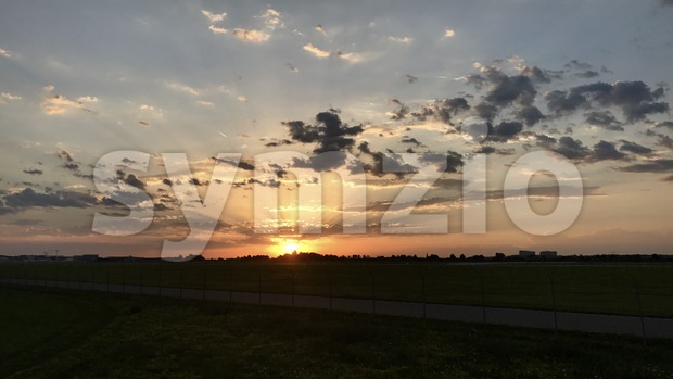 Dramatic sunset over the runway of Stuttgart airport in Germany