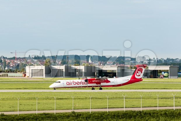Stuttgart, Germany - August 17, 2017: A plane by the bankrupt German airline AirBerlin has landed and is approaching the ...