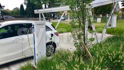 electric car being charged Stock Photo