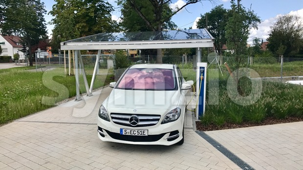 Stuttgart - August 20, 2017: A Merceds B-CLass electric car is being charged in front of a carport covered with ...