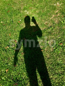 Shadow of a man using smartphone Stock Photo