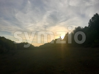 Sunset with medieval castle in Tuscany Stock Photo