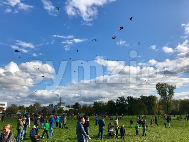 Hundreds of kites are soaring in the sky during the kite festival on the German Reunification Day Stock Photo