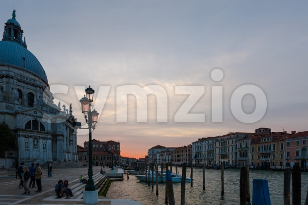 Venice, Italy - September 29, 2017: Grand Canal and Basilica Santa Maria della Salute in Venice, Italy, during sunset in ...