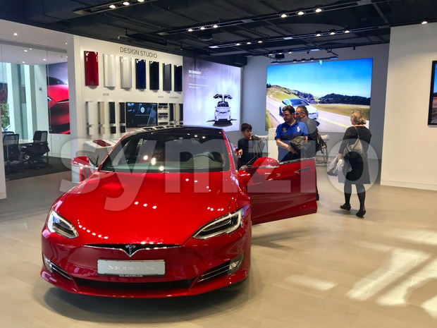 Stuttgart, Germany - October 14, 2017: People are examining the Tesla Model S in the showroom in Stuttgart, Germany.