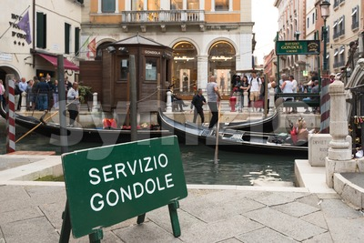 People entering the typical gondolas of Venice, Italy Stock Photo