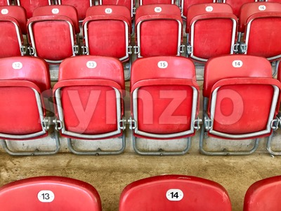 Bright red plastic seats in a stadium Stock Photo