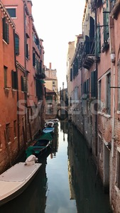 Gondolier in the small canals of Venice, Italy Stock Photo