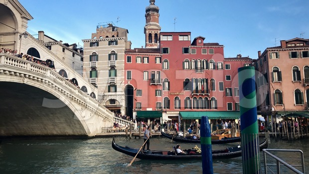 Gondoliers at the famous Rialto Bridge of Venice, Italy Stock Photo