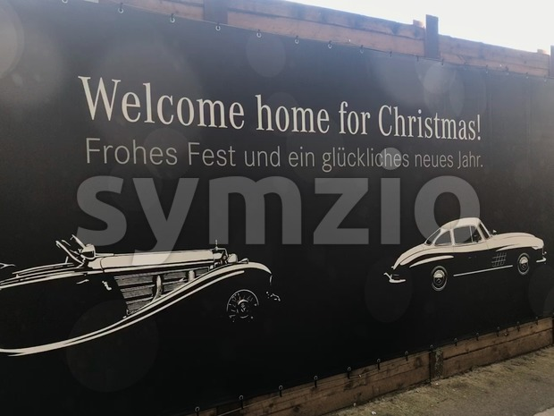 Stuttgart, Germany - December 09, 2017: Merdedes-Benz Christmas Greetings: The car manufacturer is greeting visitors to the Stuttgart Main Station ...