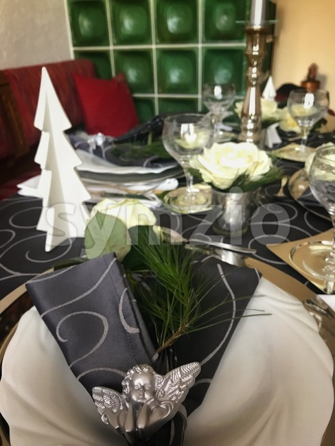 Table setting for celebration Christmas and New Year Holidays. Festive table at home with modern details