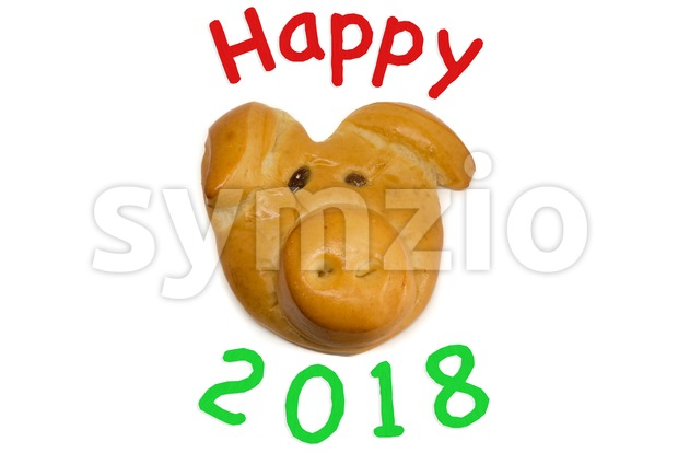 Baked lucky pig as talisman for new year with text happy 2018 on perfect white background