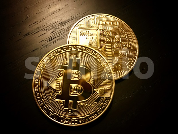 front and back of golden bitcoins Stock Photo