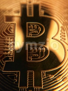 closeup of a golden bitcoin Stock Photo