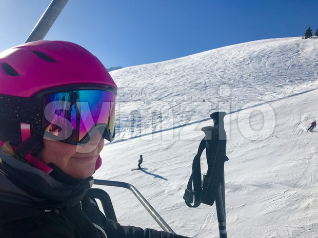 Female skier in ski lift Stock Photo