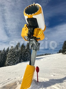 Snow cannon on skiing piste Stock Photo