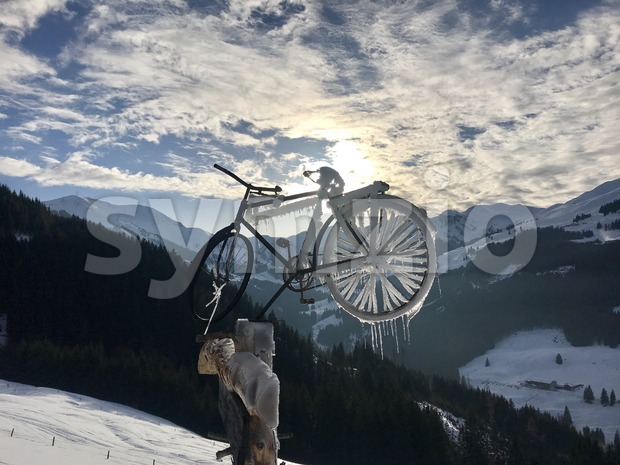 Alpine landscape and frozen bicycle Stock Photo