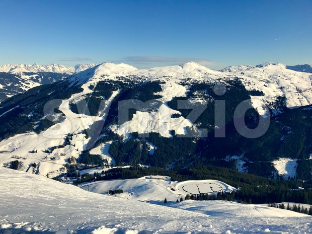 Alpine landscape with peaks covered by snow and clouds Stock Photo