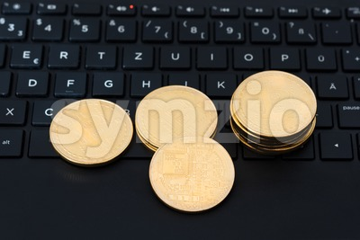 bitcoins on keyboard Stock Photo