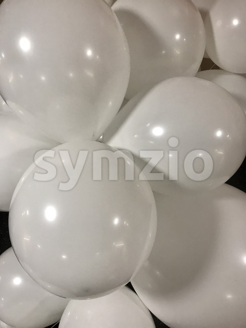 Numerous white balloons in different sizes as background