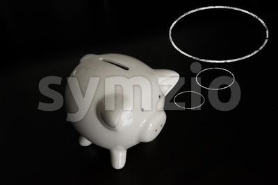 Piggy bank with thought bubbles and room for your text Stock Photo