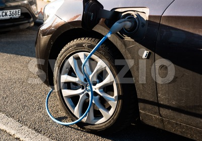 BMW i electric car being charged Stock Photo