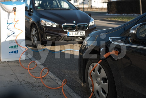 Ostfildern, Germany - February 24, 2018: A BMW i and an Opel Ampera electric cars are being charged at a ...