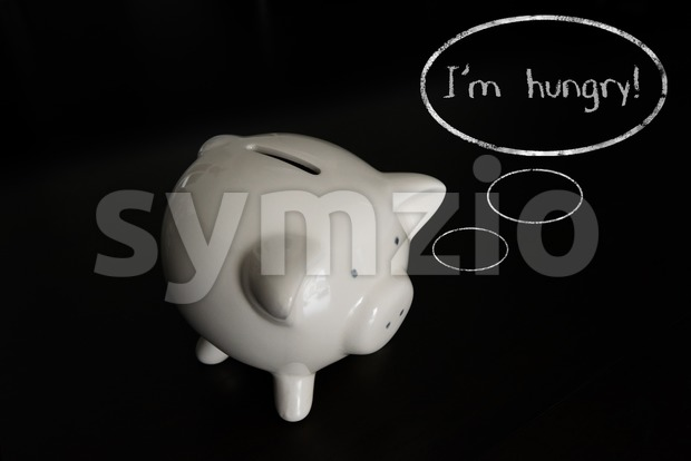 Piggy bank with thought bubbles, thinking I m hungry Stock Photo
