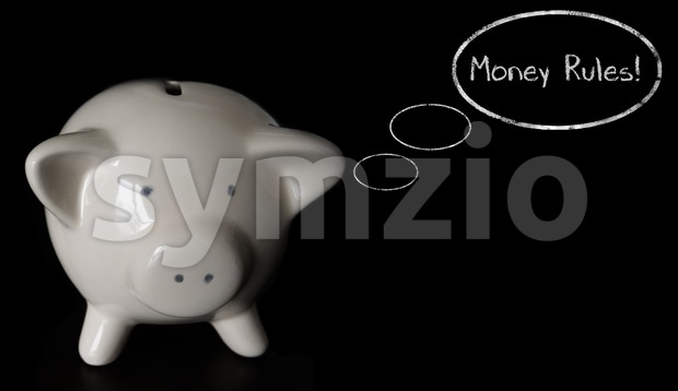 White piggy bank on dark wooden table with thought bubbles, thinking MONEY RULES!