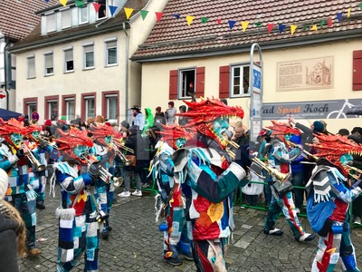 Traditional carnival in South Germany - Swabian-Alemannic Fastnacht. A local group is performing traditional Guggenmusik, brass and percussion music. Stock Photo