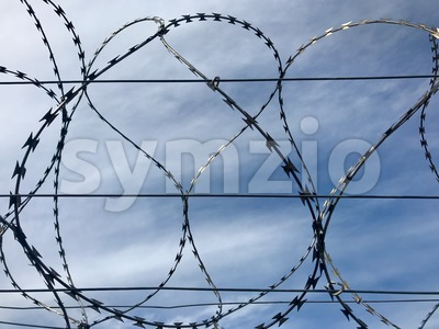 Barbed wire and sky Stock Photo