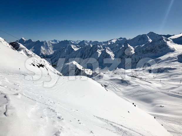 Skiing in the Stubai glacier ski resort in Tyrol, AustriaTop of Tyral - Information board at the summit of Stubai ...