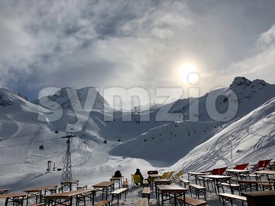 People resting in the Stubai glacier ski resort Stock Photo