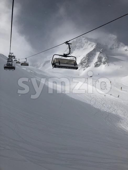 Skilift in the Stubai glacier ski resort in Tyrol, Austria during snowfall