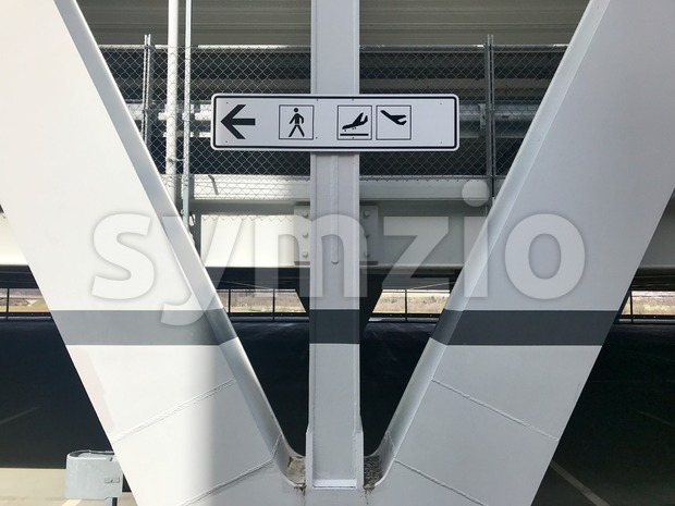 Arrivals and departures airport direction sign Stock Photo