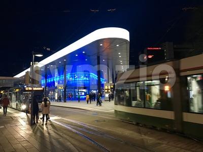 People and public transport at Koenigsplatz in Augsburg, Germany Stock Photo