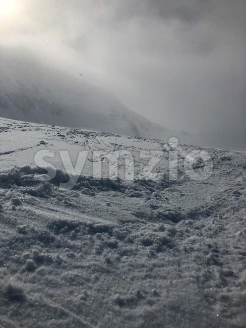 Skiing in the Stubai glacier ski resort in Tyrol, Austria during snowfall