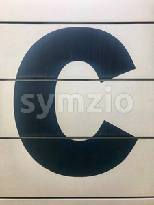 Entrance sign with letter C Stock Photo
