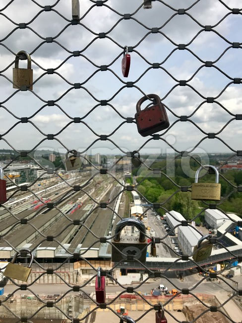 Stuttgart, Germany - April 24, 2018: Love locks on the construction site at Stuttgart main station for the Stuttgart21 railway ...