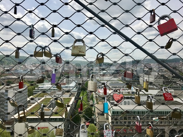 Locks of lovers high above the city Stock Photo