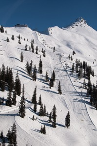 Snow covered ski piste Stock Photo
