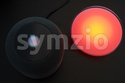Using an Apple HomePod speaker to control a smart light Stock Photo