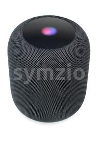 Using an Apple HomePod speaker on white Stock Photo