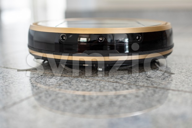 Modern autonomous robotic vacuum cleaner on bright marble floor with reflections - modern and convenient smart cleaning technology. Space for ...