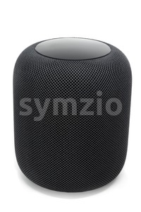 Using an Apple HomePod speaker on white Stock Photo
