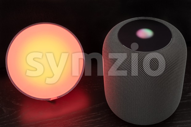Ostfildern, Germany - June 26, 2018: Using an Apple HomePod speaker to control a Philips Hue smart light - concept ...