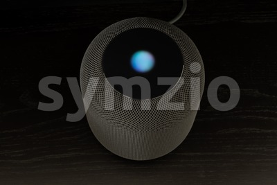 Using an Apple HomePod speaker Stock Photo